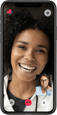 Phone showing a video call with a smiling expert on it's display